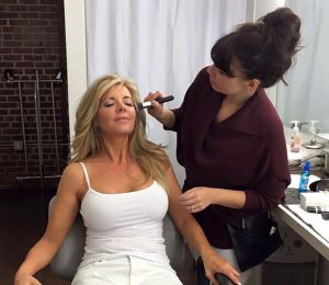 Rachel applying makeup to our real patient model